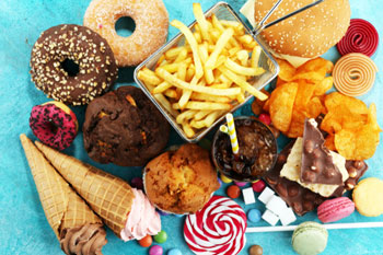 Ban junk food shops near schools, report argues image