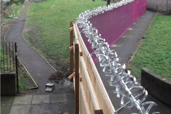Council spends £140k on 'Berlin wall-style' barrier around estate image