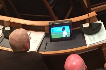 Councillors caught watching football during finance debate image