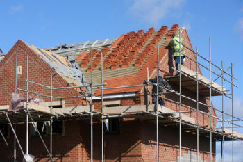 Councils urged to form joint ventures with housing associations image