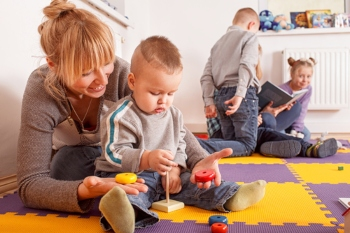 Early years' workers 'overworked and undervalued', study reveals image