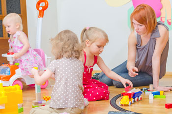 Government announces £50m grant to fund free childcare image
